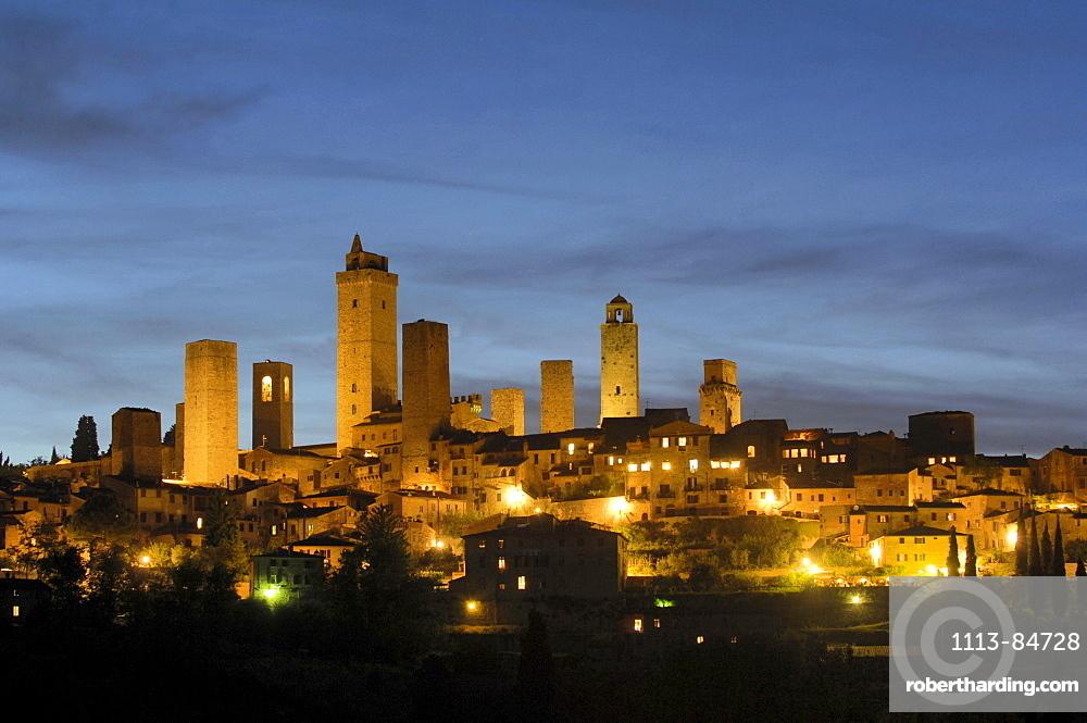 Panorama of a small medieval town at night, San Gimignano, Tuscany, Italy