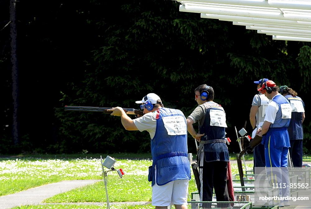 Five people standing at the firing range, Trap worldcup, Suhl, Thuringia, Germany