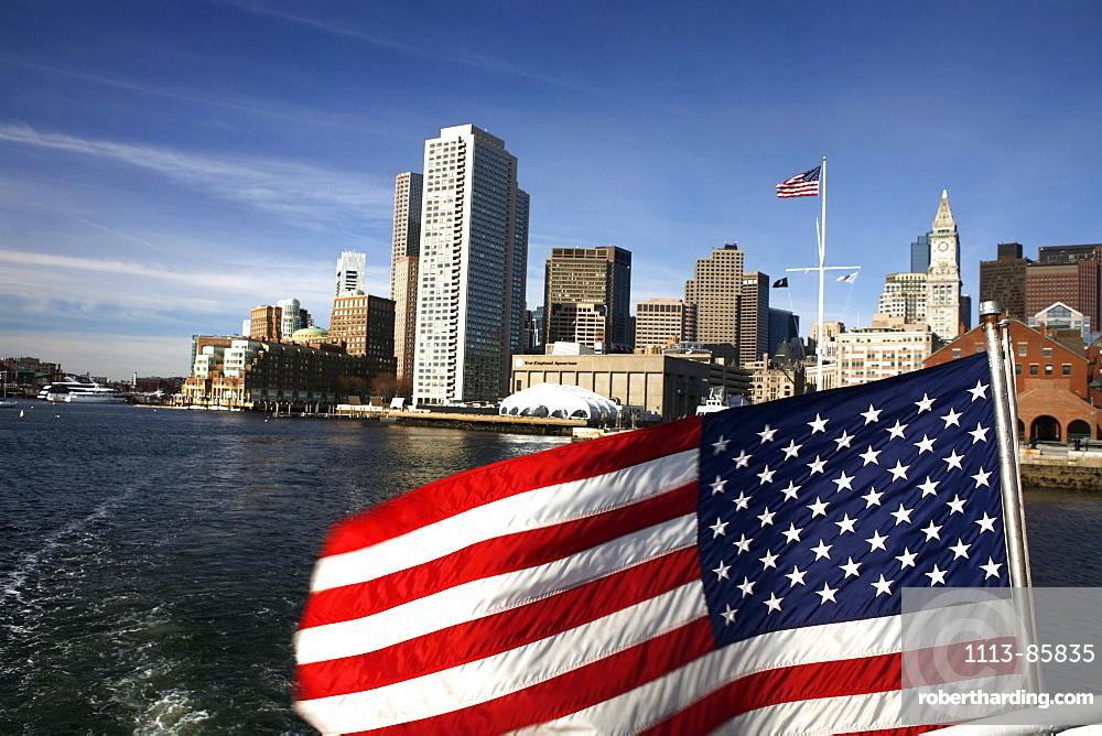 View of Boston Harbor with flag, Boston, Massachusetts, USA