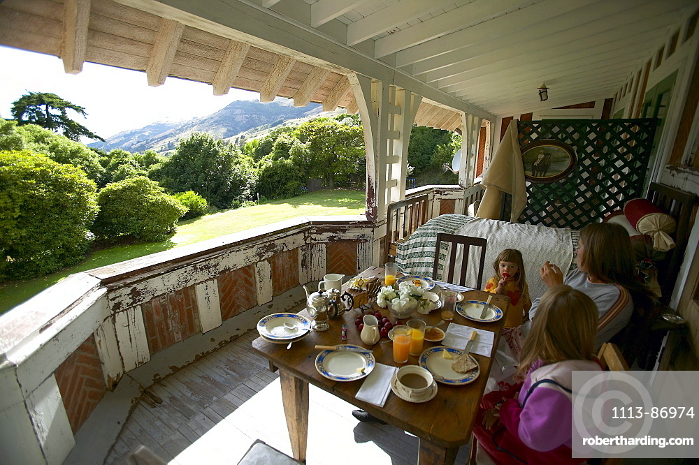 Fruehstueck on terace, Rowendale Homestead farm, B & B, Okains Bay Bank`s Peninsula, east coast, South Island, New Zealand