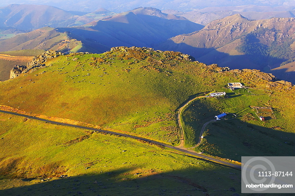 Mountains and sheep farm in the evening light, Bosque del Irati, Pyrenees, Navarra, Spain