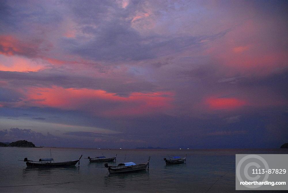 Evening sky and boats near the beach near Ko Lipe, Satun, Thailand