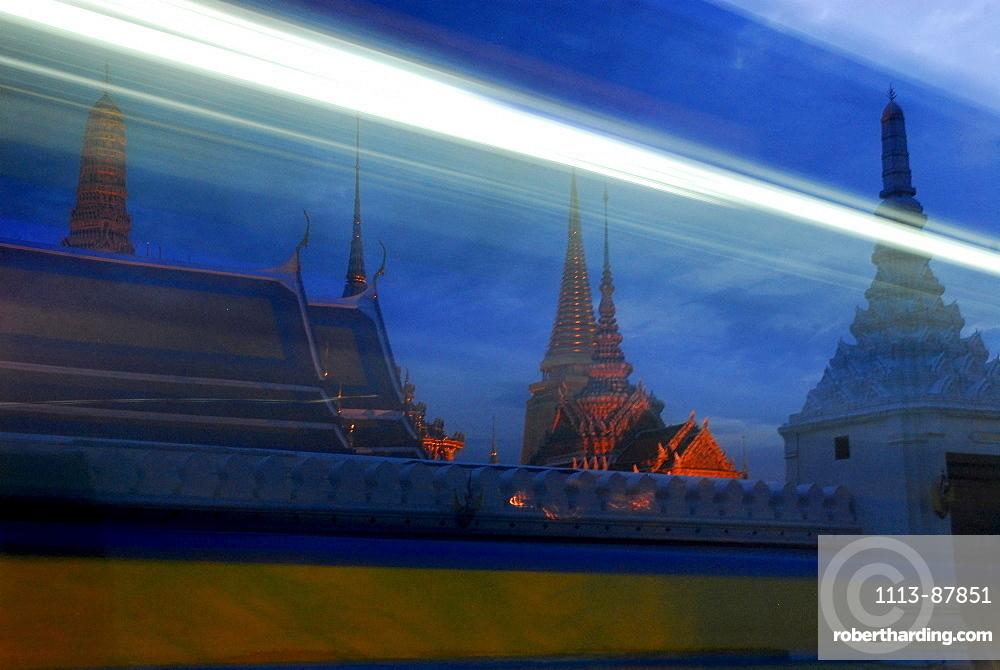 Evening traffic in front of Wat Phra Kaeo Temple, Bangkok, Thailand