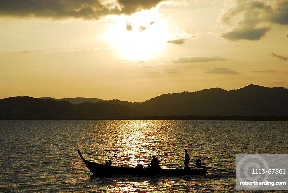 Boat in the evening light, bay of Phang Nga, Thailand