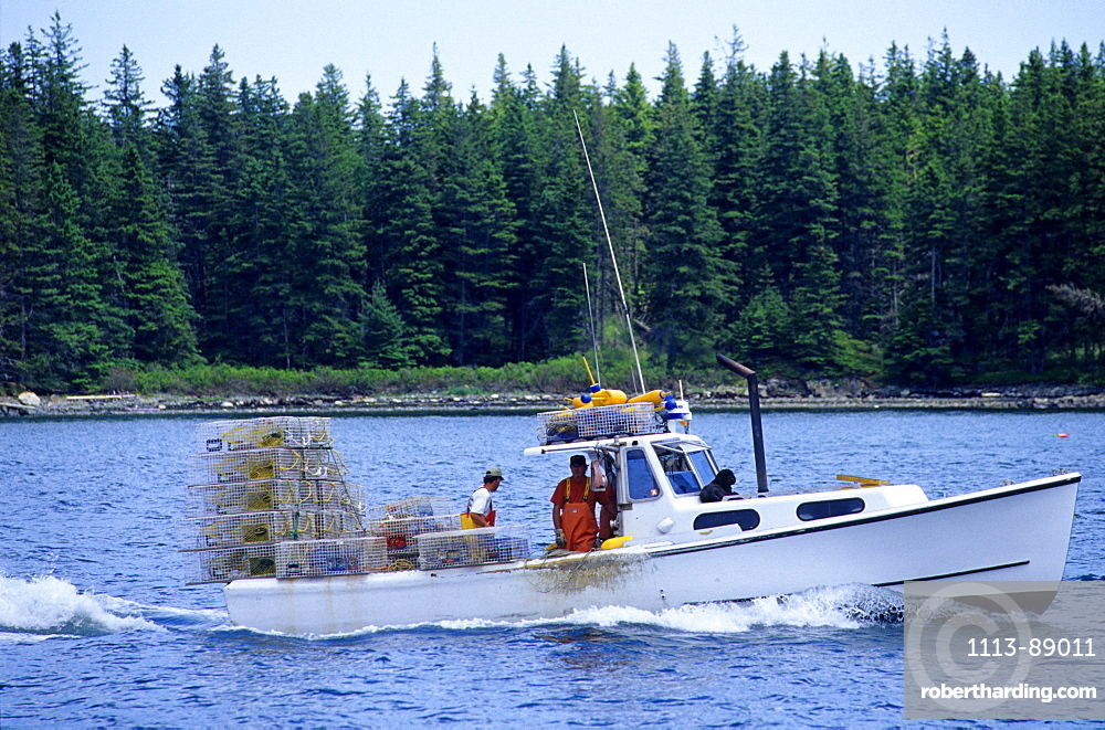 Fishing boat carrying lobster traps, Maine, USA