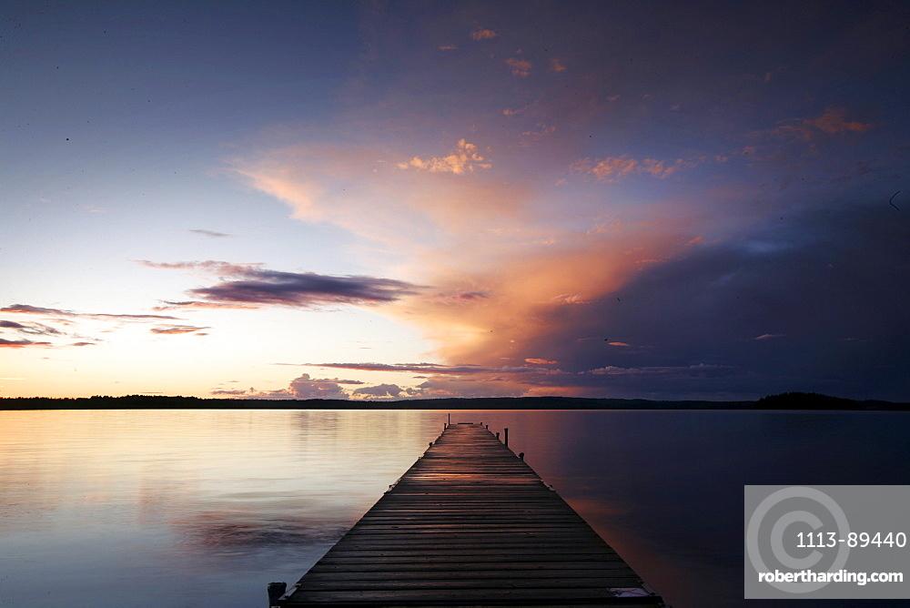 Jetty on a lake at sunrise, Madkroken near Vaexjoe, Smaland, Sweden