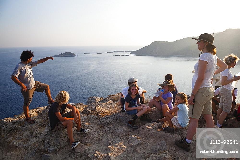 Tourists on the summit of Gemiler Island in Fethiye gulf, lycian coast, Mediterranean Sea, Turkey
