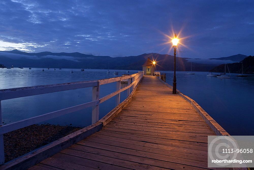 Sunset at the pavilion on Daly's Wharf, Akaroa jetty Banks Peninsula, Canterbury, South Island, New Zealand