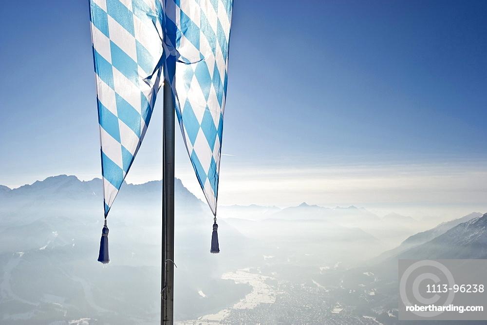 Bavarian flag on the Wank mountain, Zugspitze in the background, Garmisch-Partenkirchen, Bavaria, Germany