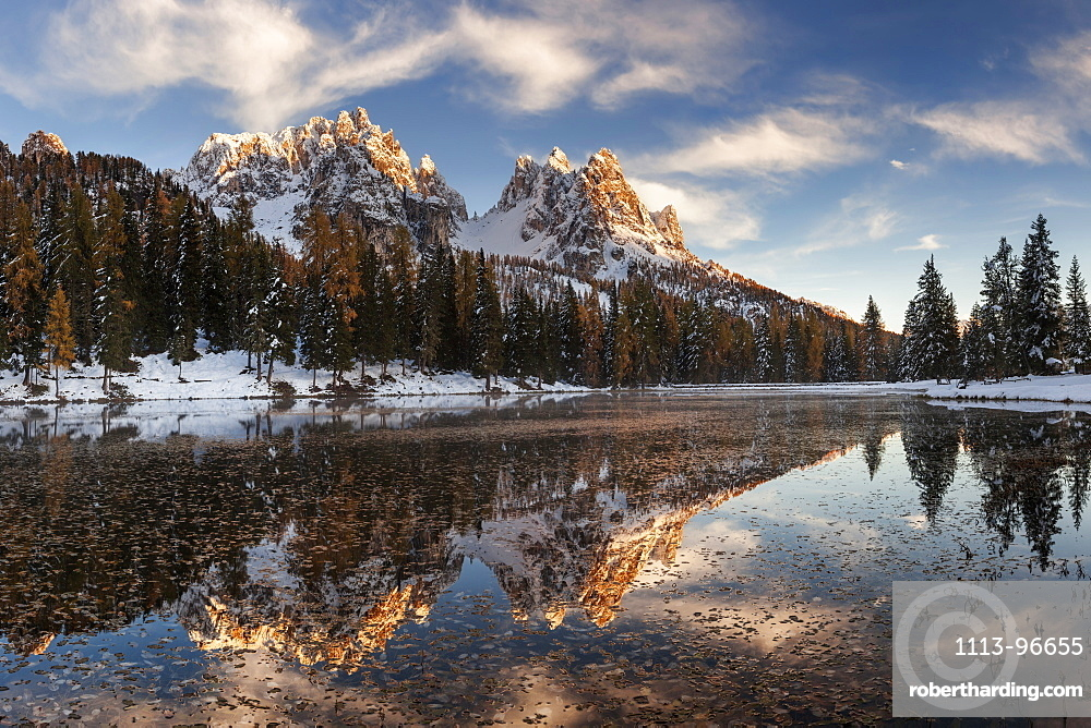 Picturesque sunset above the mirror-like Lago de Antorno with the numerous peaks of Cadini Misurina in the background, South Tyrol, Italy