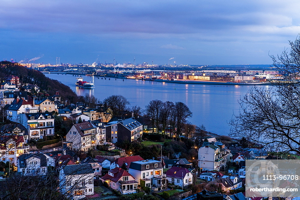 Twilight over Blankenese Treppenviertel with the river Elbe and airbus factory in the background, Hamburg, Germany