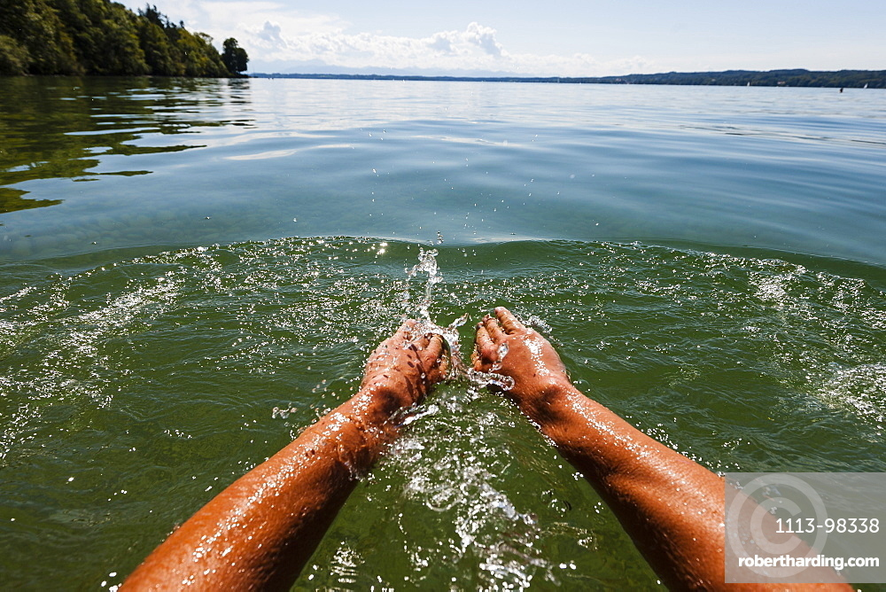Man swimming in lake Starnberg, Bavaria, Germany