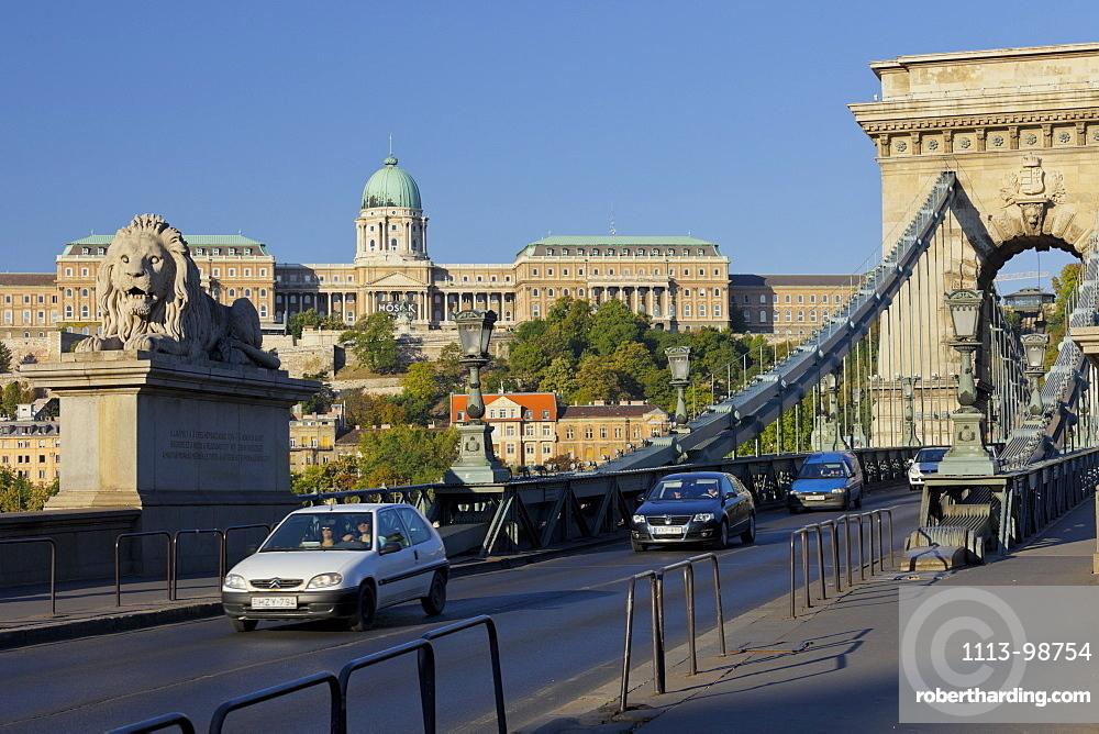 Lionstatue and traffic on the Chain Bridge, Buda Castle, Budapest, Hungary