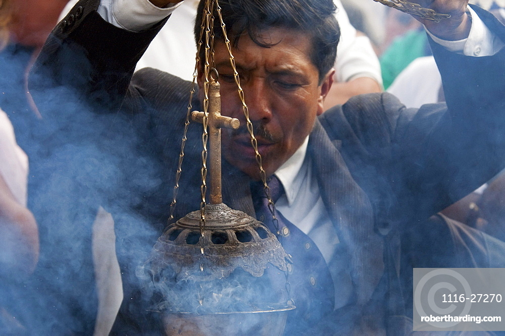 Man waiving an incense burner during the Holy Burial Procession on Good Friday in Antigua Guatemala, Sacatepéquez, Guatemala