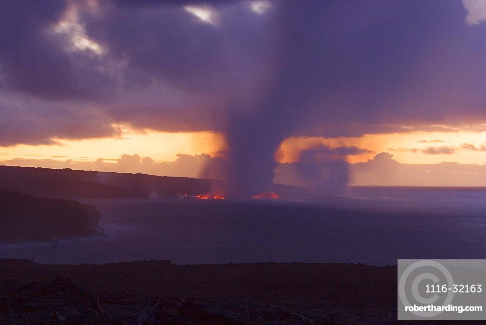 Hawaii, Big Island, Kalapana, Steam cloud formed by lava entering Pacific Ocean from Kilauea.