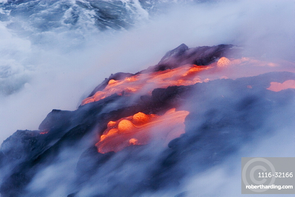 Hawaii, Big Island, near Kalapana, View from above of smoking pahoehoe lava flow into Pacific Ocean.