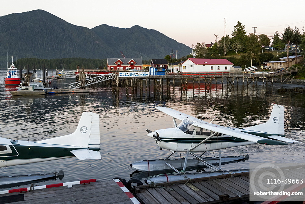 Float planes docked in Clayoquot Sound at sunset on the Pacific Rim, Vancouver Island, Tofino, British Columbia, Canada