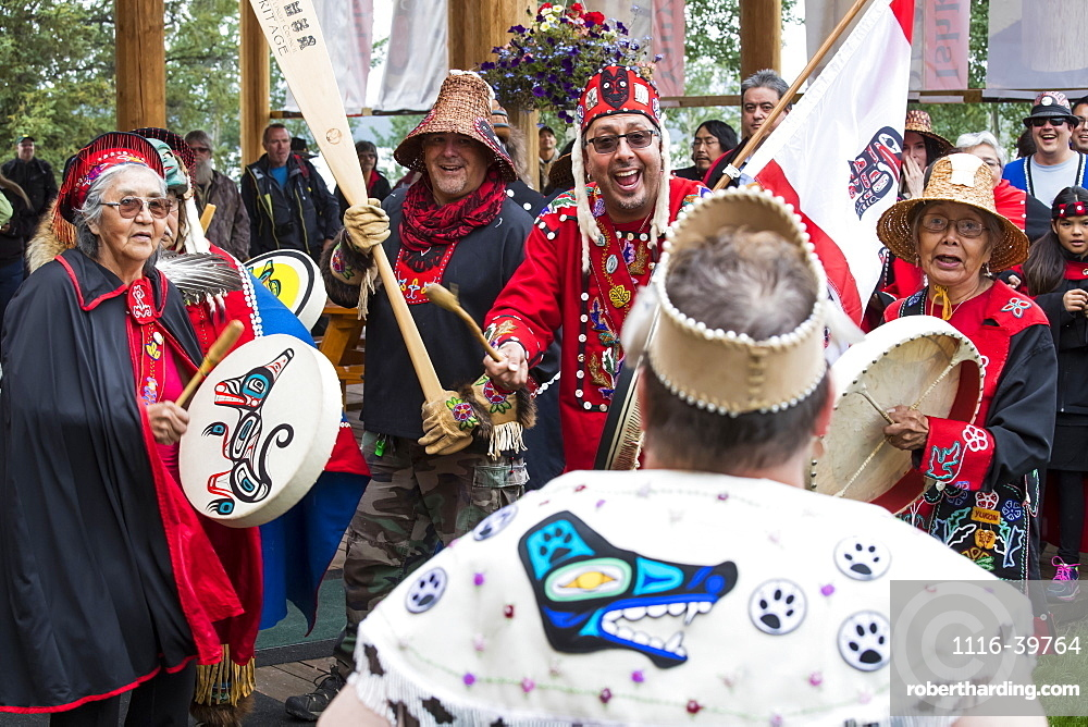 People at the Tlingit Celebration, participants are entering the hall to traditional drumming, Teslin, Yukon, Canada