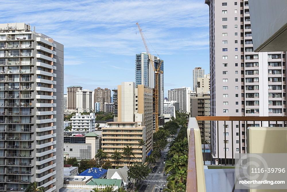 Westward view down Kuhio Avenue from a hotel balcony in Waikiki, Honolulu, Oahu, Hawaii, United States of America