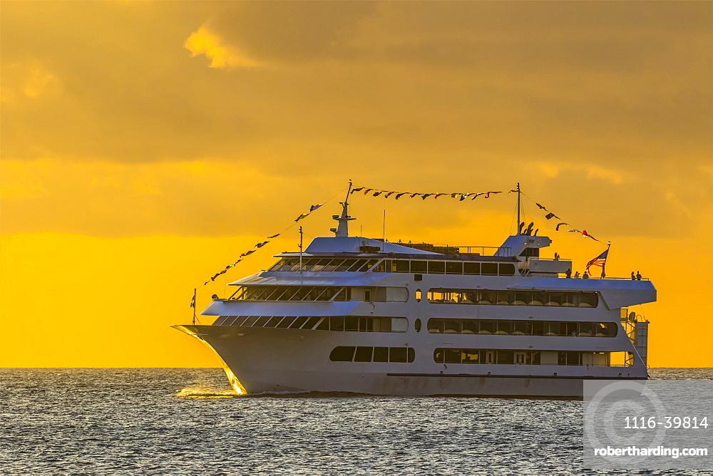 Star of Honolulu making a sunset cruise viewed from Magic Island, Ala Monana beach park, Honolulu, Oahu, Hawaii, United States of America