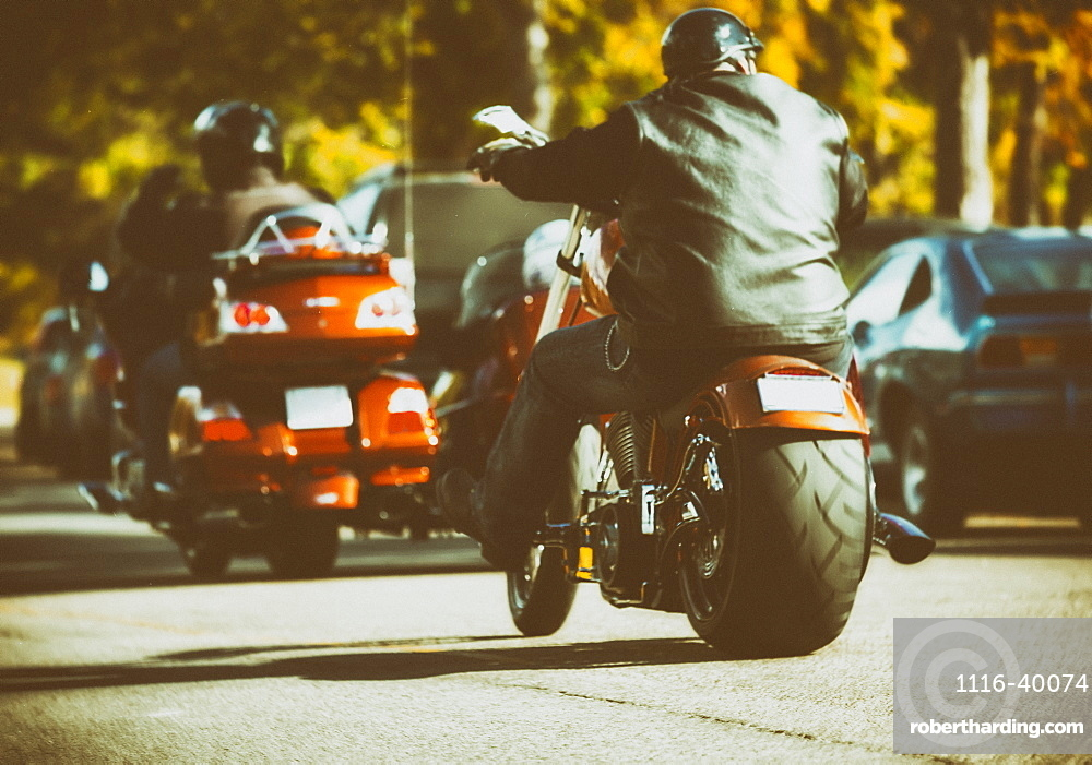 Very customized motorcycles traveling along a street during an event, Edmonton, Alberta, Canada