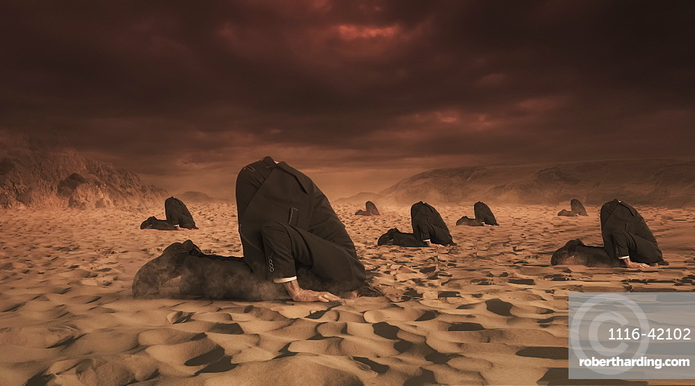 Businessmen hiding their heads in the sand, composite image