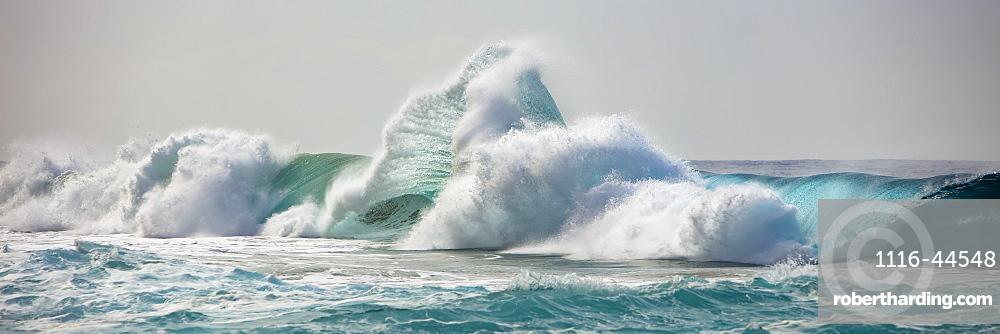Ocean waves crashing into the shore off the Na Pali coast, Kauai, Hawaii, United States of America