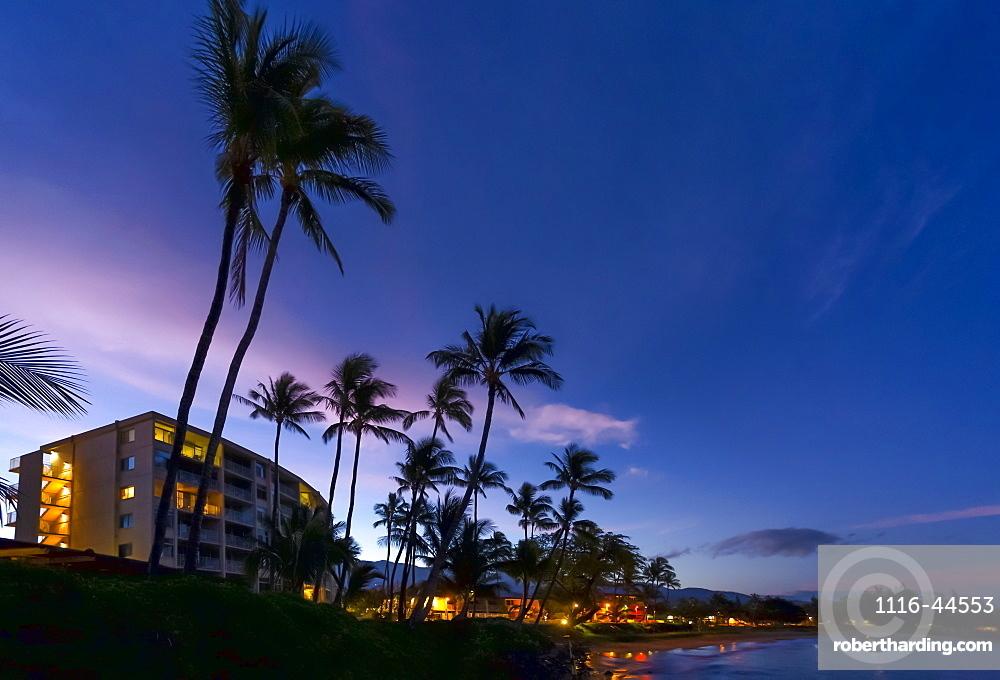 Hotels and palm trees along the coastline at sunset, Kamaole One and Two beaches, Kamaole Beach Park, Kihei, Maui, Hawaii, United States of America