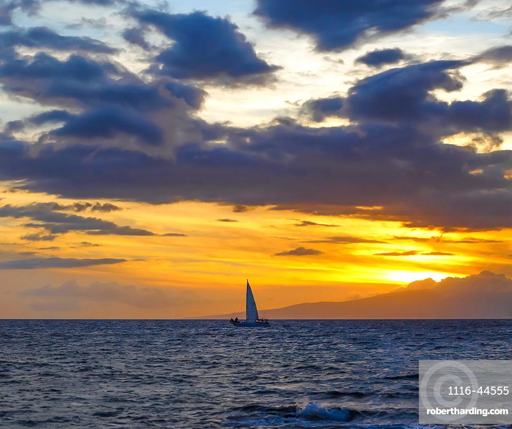 Sailboat in the ocean off the coast of Kamaole One and Two beaches, Kamaole Beach Park, Kihei, Maui, Hawaii, United States of America