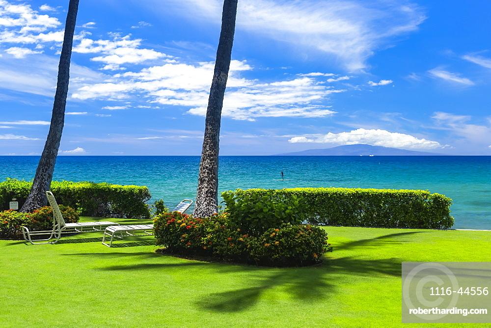 Lounge chairs on lush grass with a view, Kamaole One and Two beaches, Kamaole Beach Park, Kihei, Maui, Hawaii, United States of America