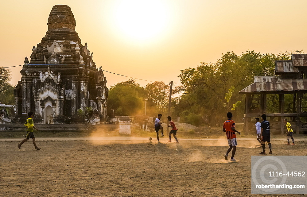 Boys playing football at sunset, Bagan, Mandalay Region, Myanmar