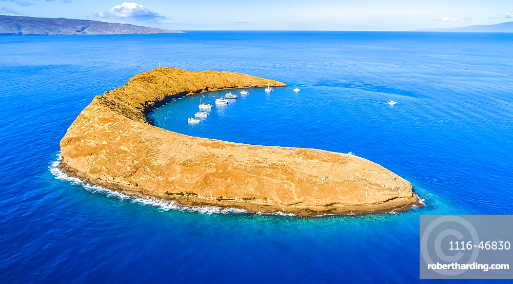Molokini Crater, aerial shot of the Maui side of the crescent shaped islet with Kahoolawe and Lanai in the distance, Maui, Hawaii, United States of America
