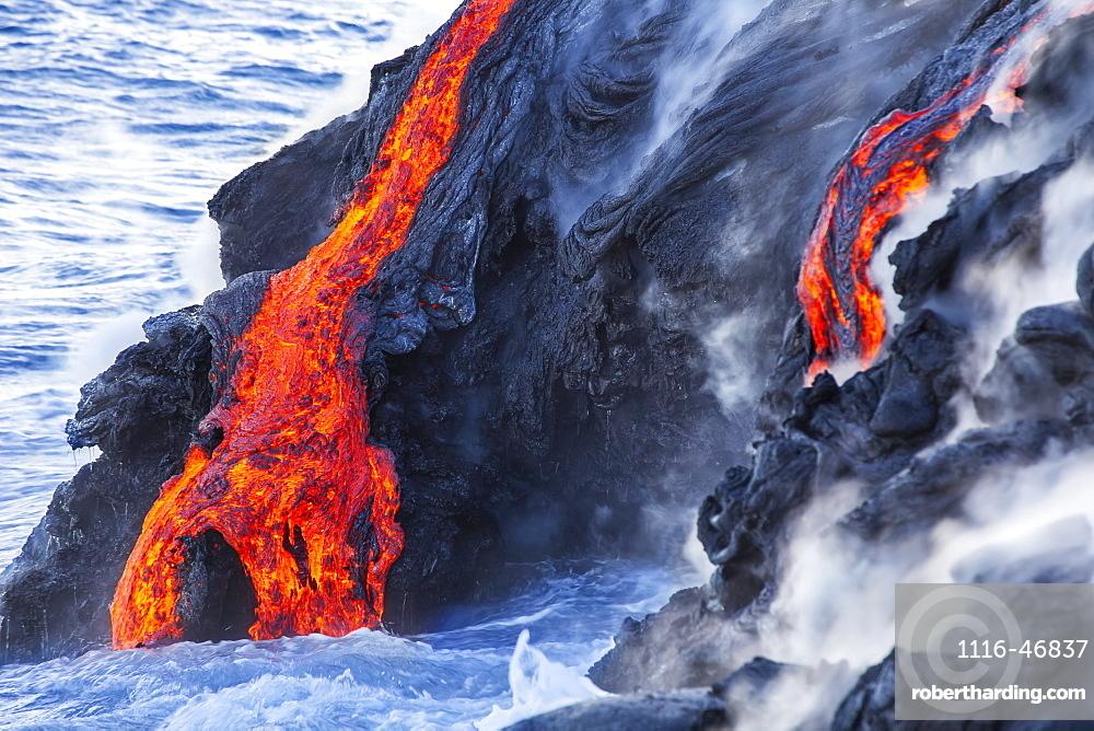 The Pahoehoe lava flowing from Kilauea has reached the Pacific ocean near Kalapana, Big Island, Island of Hawaii, Hawaii, United States of America