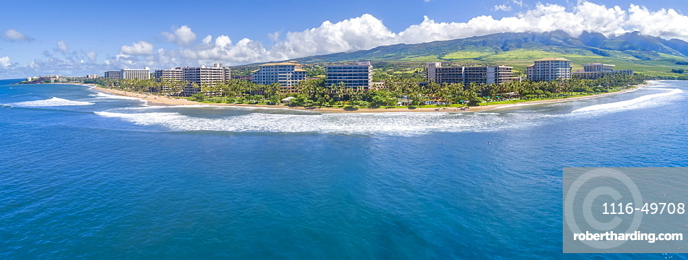 An aerial panoramic view of world famous Ka'anapali Beach from one end to the other with hotels and West Maui Mountains in the background, Maui, Hawaii, United States of America