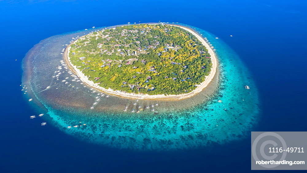 An aerial view of Balicasag Island, a tiny island in South West Bohol in the central Philippines. It is famous for scuba diving on the deep, vertical walls and there are some fantastic hard coral gardens at snorkeling depths, Balicasag Island, Philippines