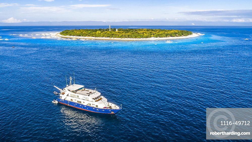 An aerial view of the live aboard vessel Infiniti for scuba diving off Balicasag Island, a tiny island in South West Bohol in the central Philippines. It is famous for scuba diving on the deep, vertical walls and there are some fantastic hard coral gardens at snorkeling depths, Balicasag Island, Philippines