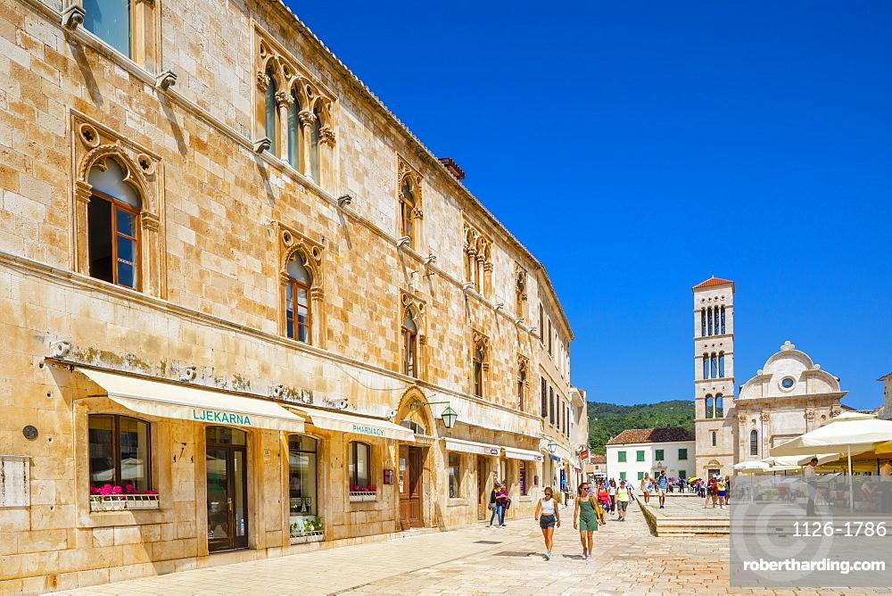 Cathedral of St. Stephen, shops and restaurants in Hvar Town, Hvar, Croatia, Europe