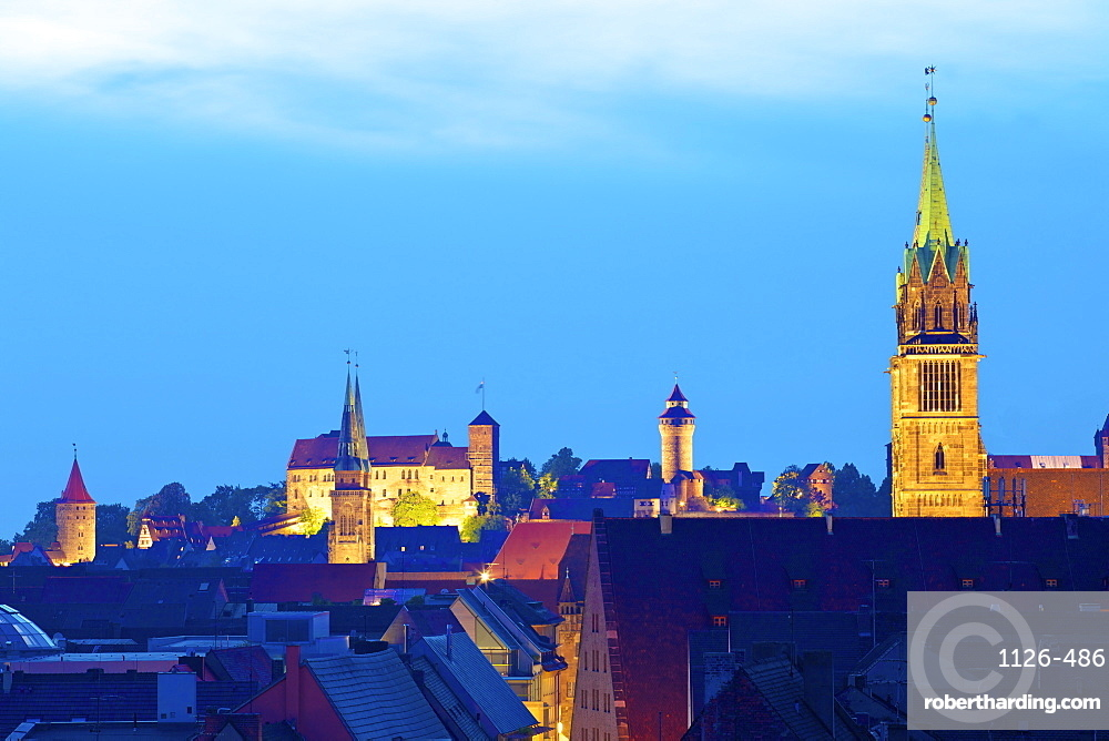 View over city at sunset with St. Lorenz, St. Sebald and the Castle in the background, Nuremberg, Bavaria, Germany, Europe