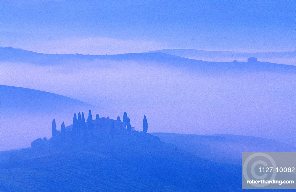 Tuscany in morning haze, Podere Belvedere, San Quirico, Tuscany, Italy