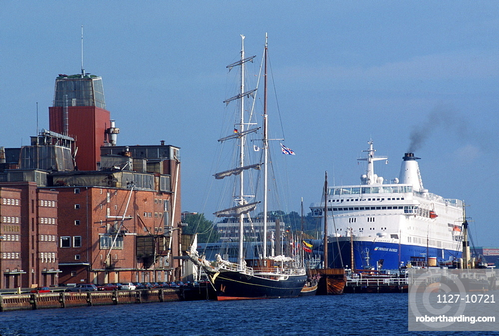 Ferry boat and sailing ship in harbour, Kiel, Schleswig-Holstein, Germany