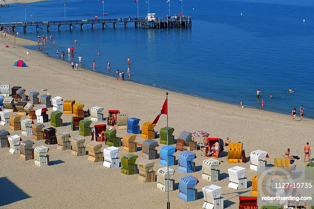 Wicker beach chairs and bathers at the beach of Wyk on Island Fohr, Schleswig-Holstein, Germany