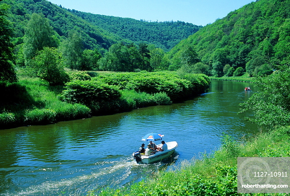 Tourists in boat on river Lahn near Bad Ems, Rhineland-Palatinate, Germany