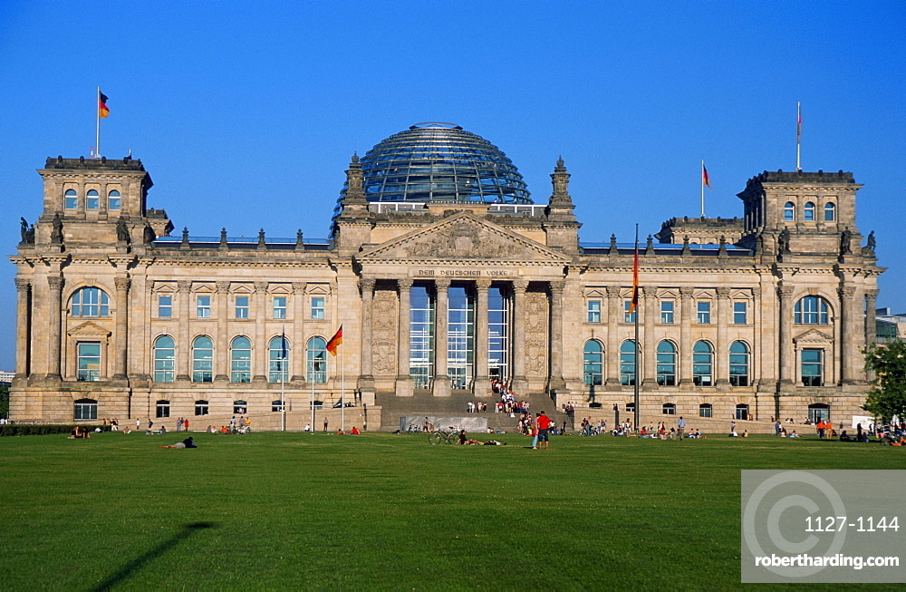 Berlin Reichstag Building with dome and German flags, Berlin, Germany / architect: Paul Wallot