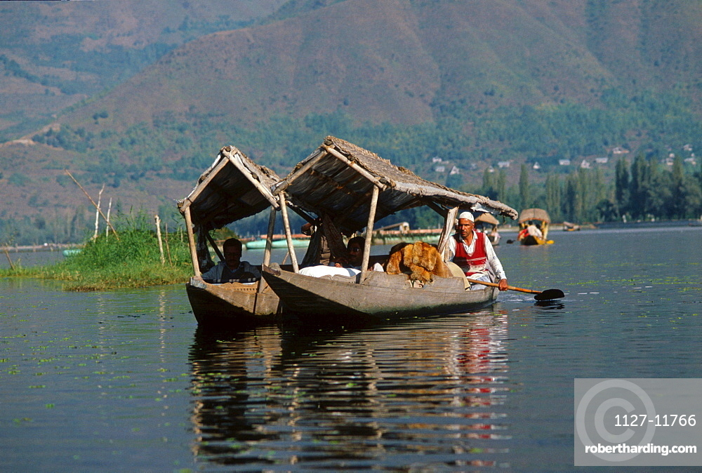 Men with rowing boats 'Shikara' on Dal lake, Srinagar, Kashmir, India