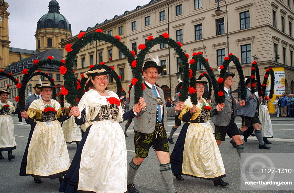 People in traditional clothes at Public Festival 'Oktoberfest', Munich, Bavaria, Germany / Munchen