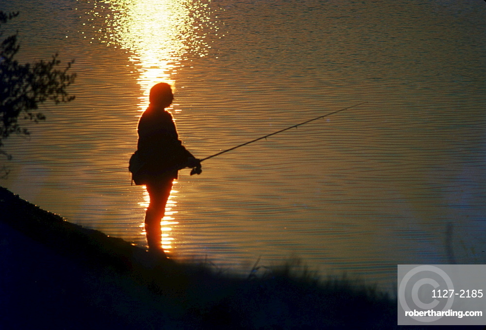 Angler at sunset, Harz, Germany