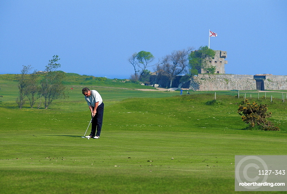 Golfer on golf course, Jersey, Channel Islands, Great Britain
