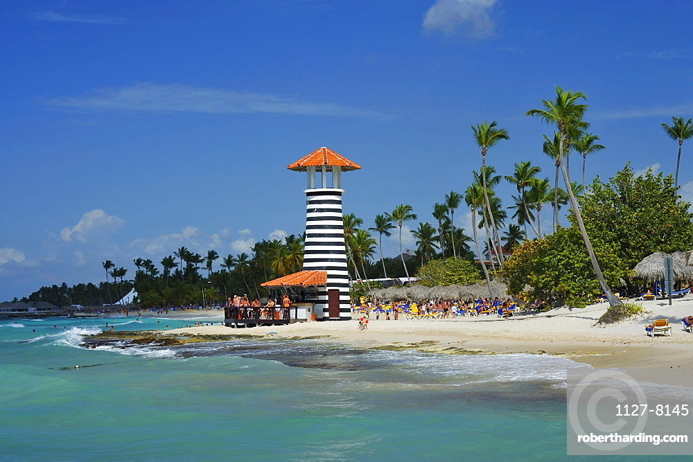 Vacationists at tropical beach, Bayahibe, Dominican Republic
