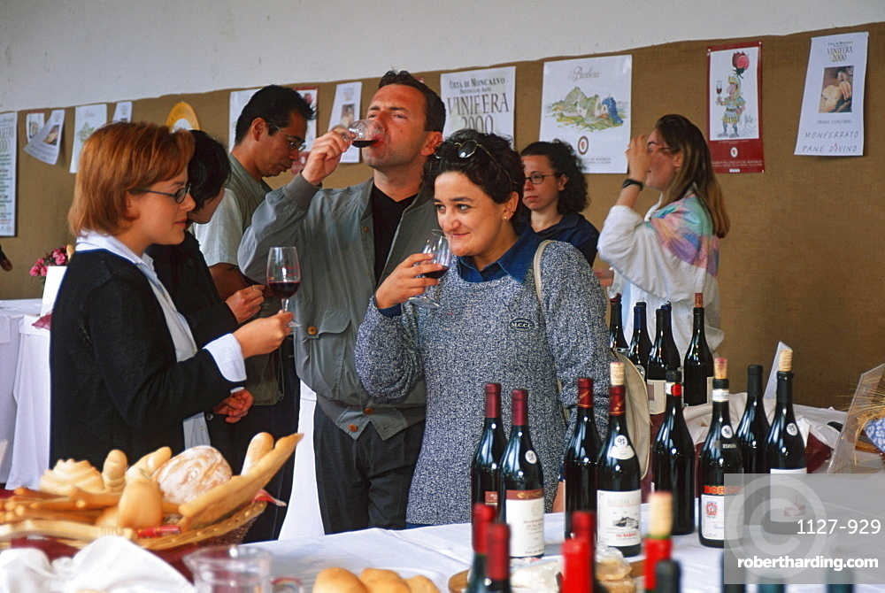 People tasting wine, kitchen festival in Moncalvo, Piemont, Italy