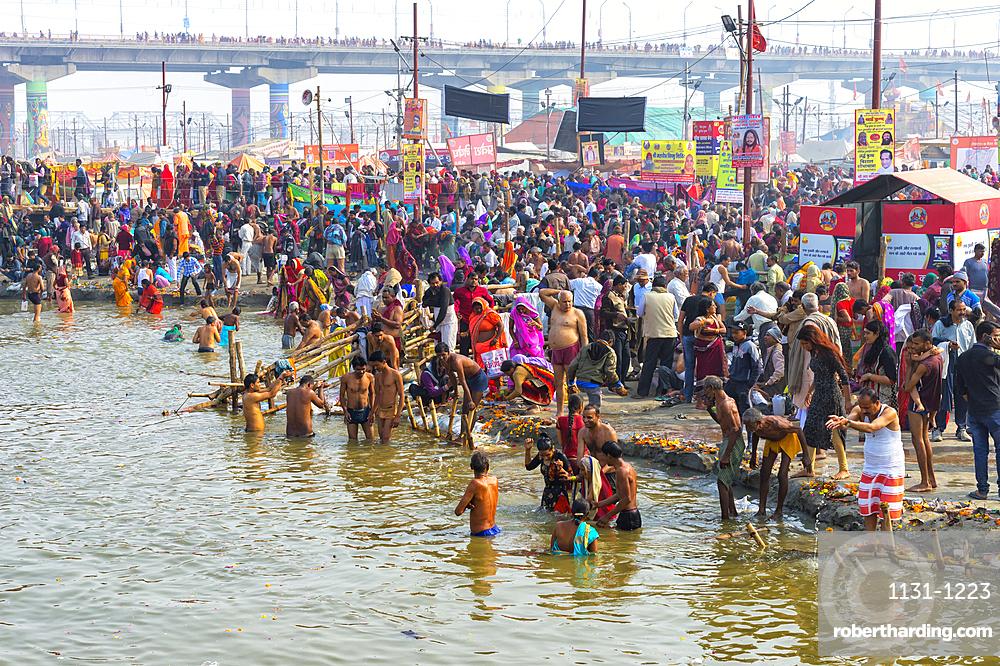Pilgrims waiting to enter the Ganges river for the ritual bathing, Allahabad Kumbh Mela, Allahabad, Uttar Pradesh, India, Asia